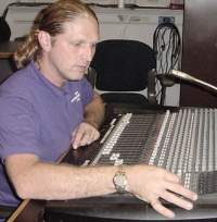 Steve Vinson, Audio Engineer working on  sound system repairs.